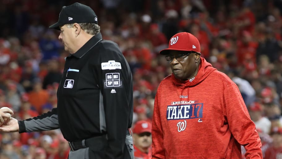 WASHINGTON, DC - OCTOBER 12: Dusty Baker #12 of the Washington Nationals argues with umpire Jerry Layne #24 during the fifth inning in game five of the National League Division Series at Nationals Park on October 12, 2017 in Washington, DC. (Photo by Win McNamee/Getty Images)