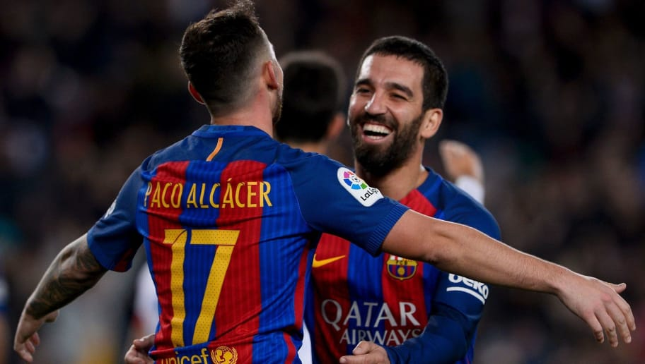 Barcelona's forward Paco Alcacer (L) is congratulated by his teammate Barcelona's Turkish midfielder Arda Turan after scoring during the Spanish Copa del Rey (King's Cup) round of 32 second leg football match FC Barcelona vs Hercules CF at the Camp Nou stadium in Barcelona on December 21, 2016. / AFP / JOSEP LAGO        (Photo credit should read JOSEP LAGO/AFP/Getty Images)