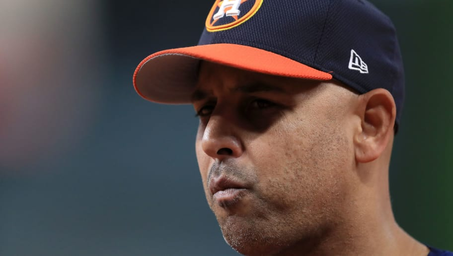 HOUSTON, TX - OCTOBER 20:  Alex Cora #26 of the Houston Astros looks on during batting practice prior to Game Six of the American League Championship Series against the New York Yankees at Minute Maid Park on October 20, 2017 in Houston, Texas.  (Photo by Ronald Martinez/Getty Images)
