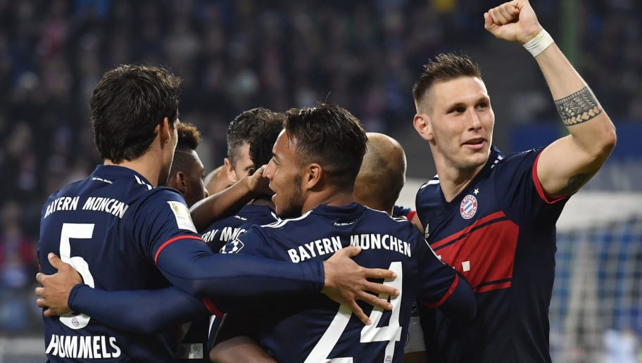 Bayern Munich's French midfielder Corentin Tolisso (front) celebrates scoring with teammates during the German first division Bundesliga football match between Hamburg SV and FC Bayern Munich in Hamburg, northern Germany, on October 21, 2017. / AFP PHOTO / John MAC DOUGALL AND JOHN MACDOUGALL / RESTRICTIONS: DURING MATCH TIME: DFL RULES TO LIMIT THE ONLINE USAGE TO 15 PICTURES PER MATCH AND FORBID IMAGE SEQUENCES TO SIMULATE VIDEO. == RESTRICTED TO EDITORIAL USE == FOR FURTHER QUERIES PLEASE CONTACT DFL DIRECTLY AT + 49 69 650050         (Photo credit should read JOHN MAC DOUGALL,JOHN MACDOUGALL/AFP/Getty Images)