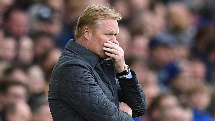 Everton's Dutch manager Ronald Koeman reacts on the touchline shortly after Arsenal scored their second goal during the English Premier League football match between Everton and Arsenal at Goodison Park in Liverpool, north west England on October 22, 2017. / AFP PHOTO / Oli SCARFF / RESTRICTED TO EDITORIAL USE. No use with unauthorized audio, video, data, fixture lists, club/league logos or 'live' services. Online in-match use limited to 75 images, no video emulation. No use in betting, games or single club/league/player publications.  /         (Photo credit should read OLI SCARFF/AFP/Getty Images)