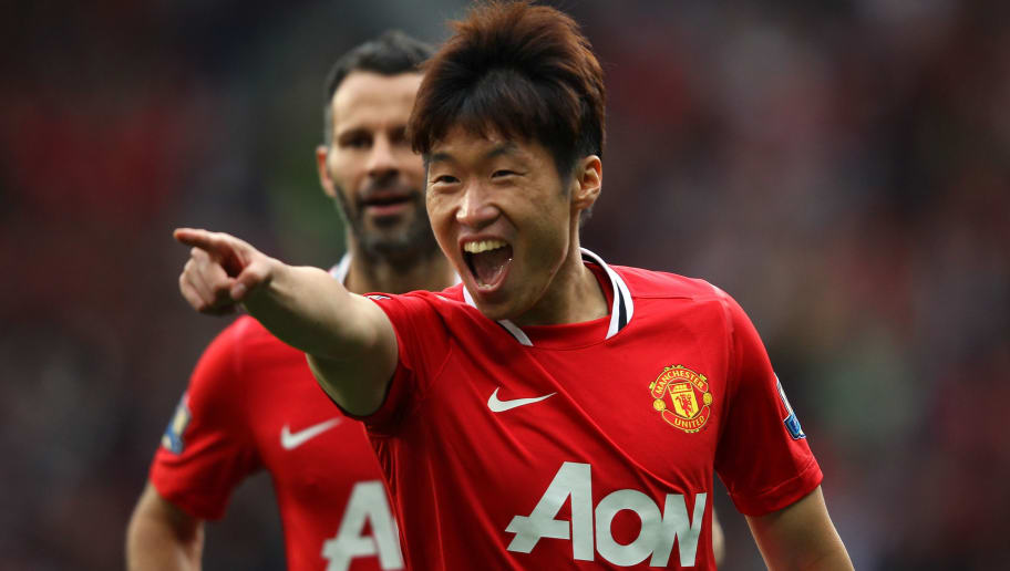 MANCHESTER, ENGLAND - AUGUST 28:  Ji-Sung Park of Manchester United celebrates with Ashley Young after scoring his goal during the Barclays Premier League match between Manchester United and Arsenal at Old Trafford on August 28, 2011 in Manchester, England.  (Photo by Alex Livesey/Getty Images)