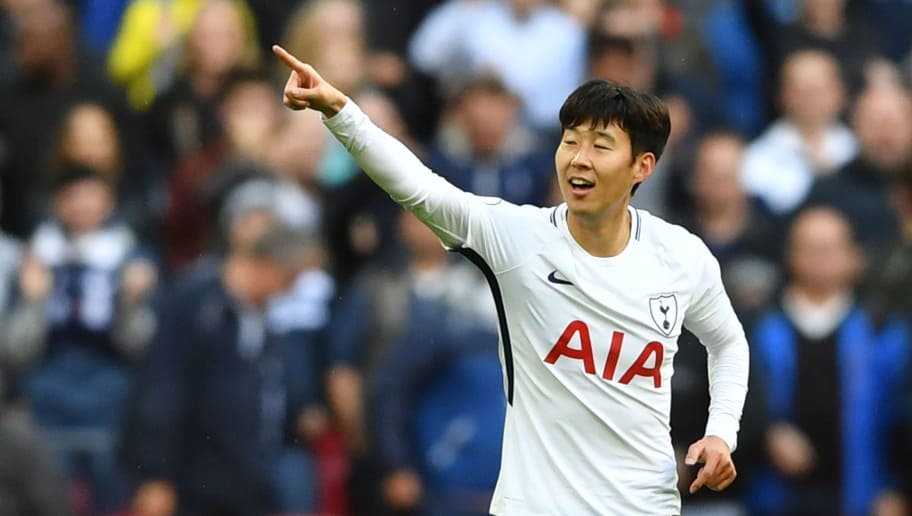 Tottenham Hotspur's South Korean striker Son Heung-Min celebrates after scoring their second goal during the English Premier League football match between Tottenham Hotspur and Liverpool at Wembley Stadium in London, on October 22, 2017. / AFP PHOTO / Ben STANSALL / RESTRICTED TO EDITORIAL USE. No use with unauthorized audio, video, data, fixture lists, club/league logos or 'live' services. Online in-match use limited to 75 images, no video emulation. No use in betting, games or single club/league/player publications.  /         (Photo credit should read BEN STANSALL/AFP/Getty Images)