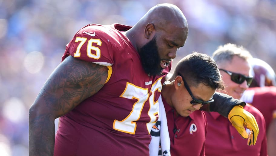 LOS ANGELES, CA - SEPTEMBER 17: Morgan Moses #76 of the Washington Redskins is helped off the field during the third quarter against the Los Angeles Rams at Los Angeles Memorial Coliseum on September 17, 2017 in Los Angeles, California. (Photo by Harry How/Getty Images)
