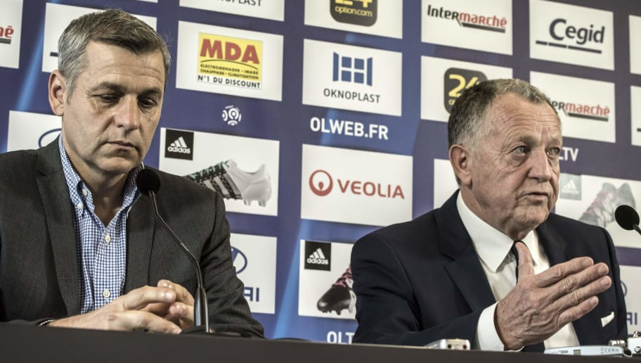 Lyon's new French head coach Bruno Genesio (L) and Lyon's French president Jean-Michel Aulas (R) hold a press conference at the OL (Olympique Lyonnais) training center in Lyon, central eastern France, on december 28, 2015. / AFP / JEAN-PHILIPPE KSIAZEK        (Photo credit should read JEAN-PHILIPPE KSIAZEK/AFP/Getty Images)