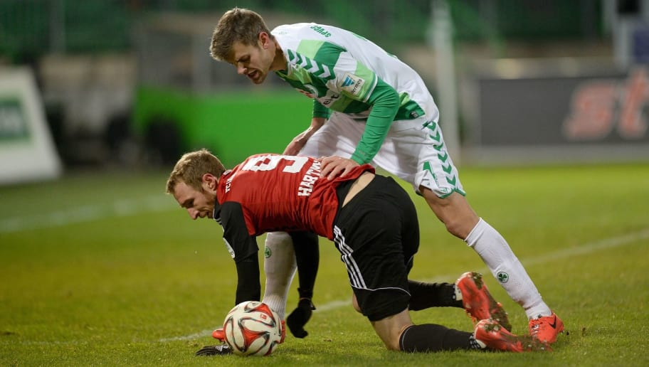 FUERTH, GERMANY - FEBRUARY 06: Stefan Thesker (R) of Fuerth challenges Moritz Hartmann of Ingolstadt during the Second Bundesliga match between Greuther Fuerth and FC Ingolstadt at Trolli Arena on February 6, 2015 in Fuerth, Germany.  (Photo by Micha Will/Bongarts/Getty Images)