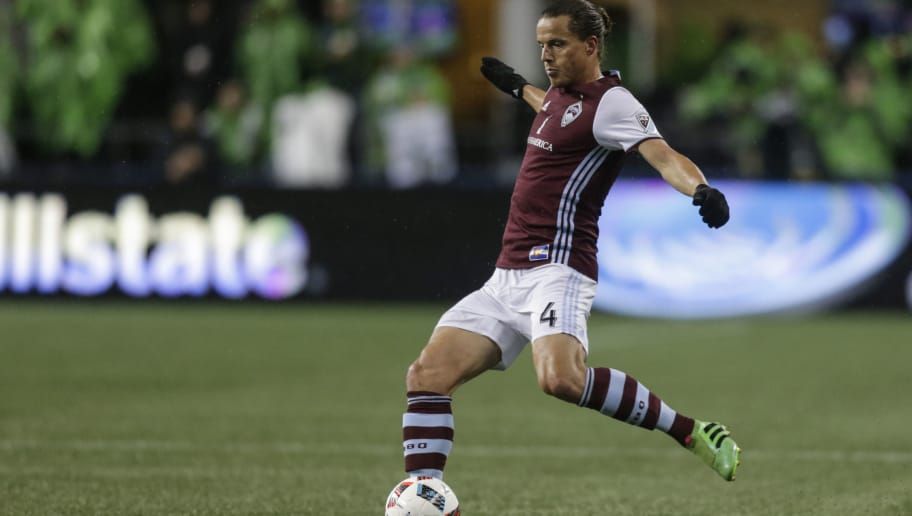 SEATTLE, WA - NOVEMBER 22: Marc Burch #4 of the Colorado Rapids passes the ball during a match against the Seattle Sounders in the first leg of the Western Conference Finals at CenturyLink Field on November 22, 2016 in Seattle, Washington. The Sounders won the match 2-1. (Photo by Stephen Brashear/Getty Images)