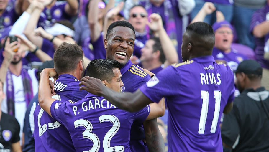 ORLANDO, FL - MARCH 05:  Cyle Larin #9 of Orlando City SC celebrates his goal with Matias Perez Garcia #32 and Carlos Rivas #11 and Antonio Nocerino #23 of Orlando City SC during a MLS soccer match between New York City FC and Orlando City SC at the Orlando City Stadium on March 5, 2017 in Orlando, Florida. (Photo by Alex Menendez/Getty Images)