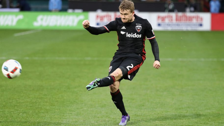 WASHINGTON, DC - MARCH 20:  Taylor Kemp #2 of D.C. United passes the ball against the Colorado Rapids at RFK Stadium on March 20, 2016 in Washington, DC.  (Photo by Rob Carr/Getty Images)
