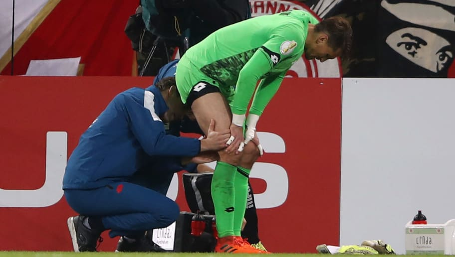 MAINZ, GERMANY - OCTOBER 24:  Injured goalkeeper Rene Adler of Mainz receives treatment before being substituted during the DFB Cup match between 1. FSV Mainz 05 and Holstein Kiel at Opel Arena on October 24, 2017 in Mainz, Germany.  (Photo by Alex Grimm/Bongarts/Getty Images)