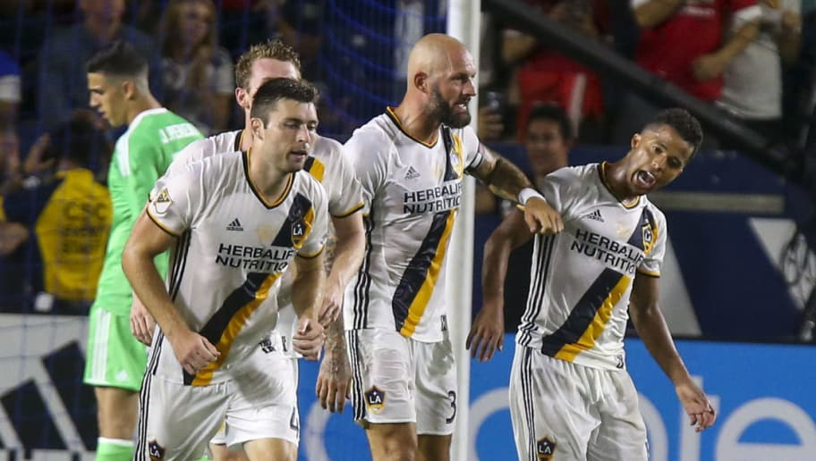 Los Angeles Galaxy's Dave Romney (L) and Jelle Van Damme (C) celebrate a goal with other team mates against Manchester United during the second half of a friendly soccer game at StubHub Center on July 15, 2017 in Carson, California.  Manchester United won 5-2.  / AFP PHOTO / RINGO CHIU        (Photo credit should read RINGO CHIU/AFP/Getty Images)