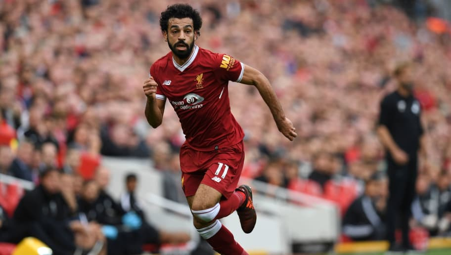 Liverpool's Egyptian midfielder Mohamed Salah runs with the ball during the English Premier League football match between Liverpool and Manchester United at Anfield in Liverpool, north west England on October 14, 2017. / AFP PHOTO / Paul ELLIS / RESTRICTED TO EDITORIAL USE. No use with unauthorized audio, video, data, fixture lists, club/league logos or 'live' services. Online in-match use limited to 75 images, no video emulation. No use in betting, games or single club/league/player publications.  /         (Photo credit should read PAUL ELLIS/AFP/Getty Images)