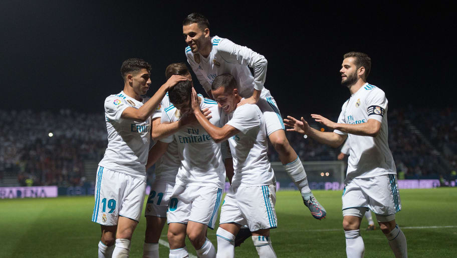 MADRID, SPAIN - OCTOBER 26: Marco Asensio of Real Madrid CF celebrates with teammates after scoring his team's opening goal from a penalty kick during the Copa del Rey, Round of 32, First Leg match between Fuenlabrada and Real Madrid at Estadio Fernando Torres on October 26, 2017 in Madrid, Spain. (Photo by Denis Doyle/Getty Images)