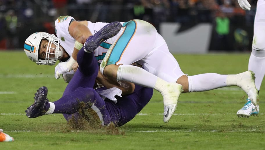 BALTIMORE, MD - OCTOBER 26: Quarterback Joe Flacco #5 of the Baltimore Ravens is hit by middle linebacker Kiko Alonso #47 of the Miami Dolphins as he slides in the second quarter against the Miami Dolphins at M&T Bank Stadium on October 26, 2017 in Baltimore, Maryland. (Photo by Patrick Smith/Getty Images)