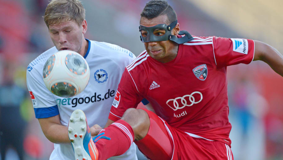 INGOLSTADT, GERMANY - AUGUST 23: Fabian Klos (L) of Bielefeld and Marvin Matip of Ingolstadt fight for the ball during the Second Bundesliga match between FC Ingolstadt and Arminia Bielefeld at the Audi Sportpark on August 23, 2013 in Ingolstadt, Germany.  (Photo by Thomas Starke/Bongarts/Getty Images)