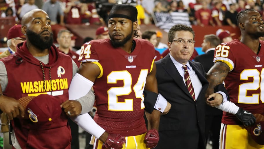 LANDOVER, MD - SEPTEMBER 24: Washington Redskins Owner Daniel Synder stands with cornerback Josh Norman #24 and cornerback Bashaud Breeland #26 during the the national anthem before the game against the Oakland Raiders at FedExField on September 24, 2017 in Landover, Maryland. (Photo by Patrick Smith/Getty Images)