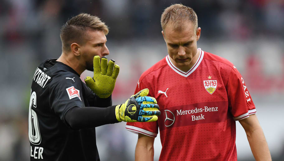 FRANKFURT AM MAIN, GERMANY - SEPTEMBER 30: Ron-Robert Zieler of Stuttgart (l) with Holger Badstuber of Stuttgart dejected after their late loss after the Bundesliga match between Eintracht Frankfurt and VfB Stuttgart at Commerzbank-Arena on September 30, 2017 in Frankfurt am Main, Germany. (Photo by Matthias Hangst/Bongarts/Getty Images)