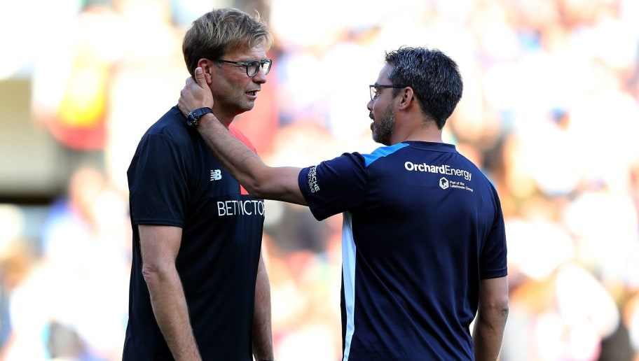 HUDDERSFIELD, ENGLAND - JULY 20:  David Wagner (R) manager of Huddersfield Town greets Juergen Klopp manager of Liverpool prior the Pre-Season Friendly match between Huddersfield Town and Liverpool at the Galpharm Stadium on July 20, 2016 in Huddersfield, England.  (Photo by Nigel Roddis/Getty Images)