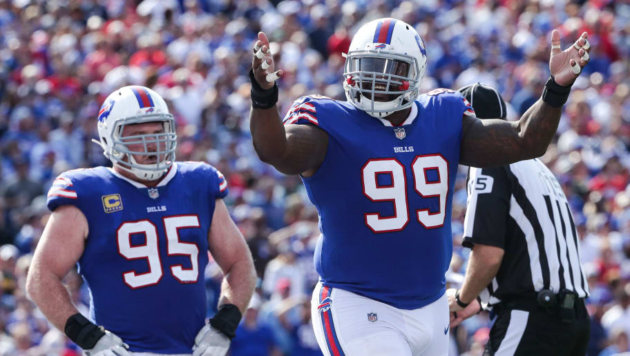 ORCHARD PARK, NY - SEPTEMBER 10:  Marcell Dareus #99 of the Buffalo Bills celebrates as teammate Kyle Williams #95 looks on during the second half against the New York Jets on September 10, 2017 at New Era Field in Orchard Park, New York.  (Photo by Tom Szczerbowski/Getty Images)