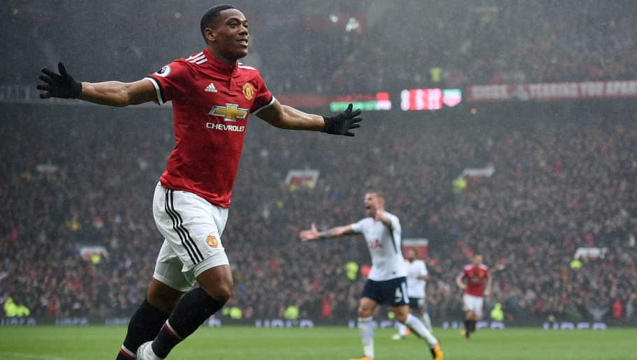 Manchester United's French striker Anthony Martial celebrates after scoring the opening goal of the English Premier League football match between Manchester United and Tottenham Hotspur at Old Trafford in Manchester, north west England, on October 28, 2017. Manchester United won the game 1-0. / AFP PHOTO / Oli SCARFF / RESTRICTED TO EDITORIAL USE. No use with unauthorized audio, video, data, fixture lists, club/league logos or 'live' services. Online in-match use limited to 75 images, no video emulation. No use in betting, games or single club/league/player publications.  /         (Photo credit should read OLI SCARFF/AFP/Getty Images)