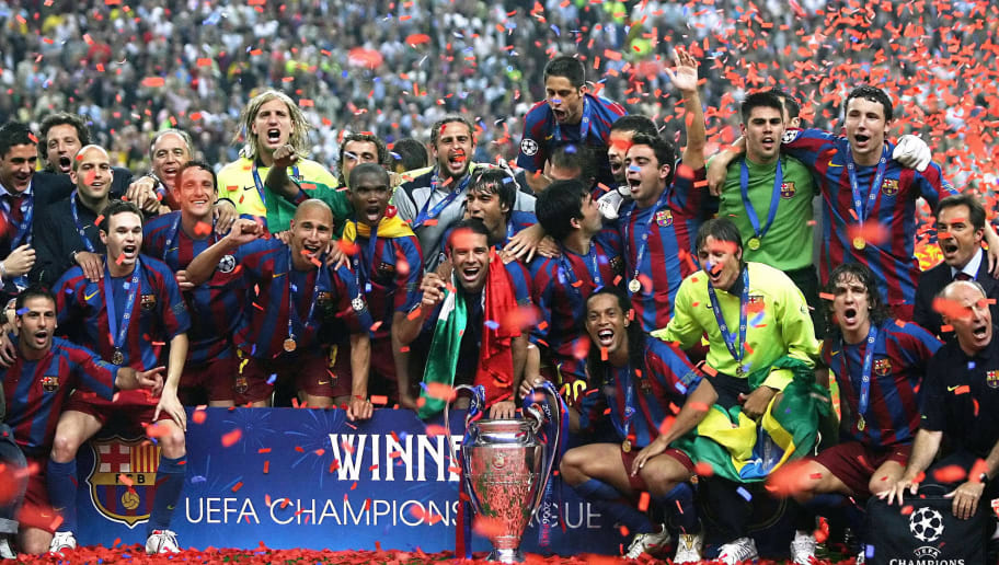 Saint-Denis, FRANCE:  Barcelona's players celebrate with the trophy after winning the UEFA Champion's League final football match against Arsenal, 17 May 2006 at the Stade de France in Saint-Denis, northern Paris. Barcelona won 2 to 1.  AFP PHOTO LLUIS GENE  (Photo credit should read LLUIS GENE/AFP/Getty Images)