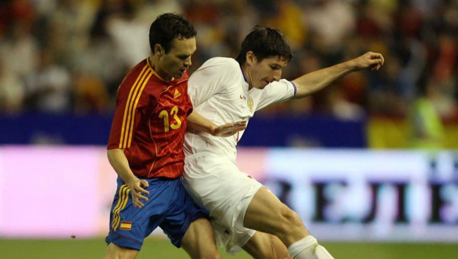 Albacete, SPAIN:  Spain's Andres Iniesta (L) stops Russia's Aldonin during a friendly international football match at the Carlos Belmonte stadium in Albacete, 27 May 2006.   AFP PHOTO/PIERRE-PHILIPPE MARCOU  (Photo credit should read PIERRE-PHILIPPE MARCOU/AFP/Getty Images)