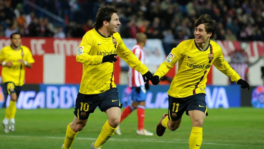MADRID, SPAIN - JANUARY 06:  Lionel Messi (L) of Barcelona celebrates scoring the opening goal with his teammate Bojan Krkic during the round of last 16 Copa del Rey match between Atletico Madrid and Barcelona at the Vicente Calderon Stadium on January 6, 2009 in Madrid, Spain. Barcelona won the match 3-1 with Messi scoring all three goals for his side.  (Photo by Jasper Juinen/Getty Images)