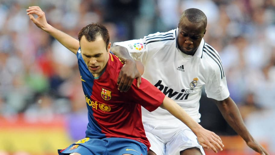 Real Madrid's French Lassana Diarra (R) fights for the ball against Barcelona's Andrés Iniesta (L) during a Spanish league football match at the Santiago Bernabeu stadium in Madrid on May 2, 2009.  AFP PHOTO/JAVIER SORIANO. (Photo credit should read JAVIER SORIANO/AFP/Getty Images)