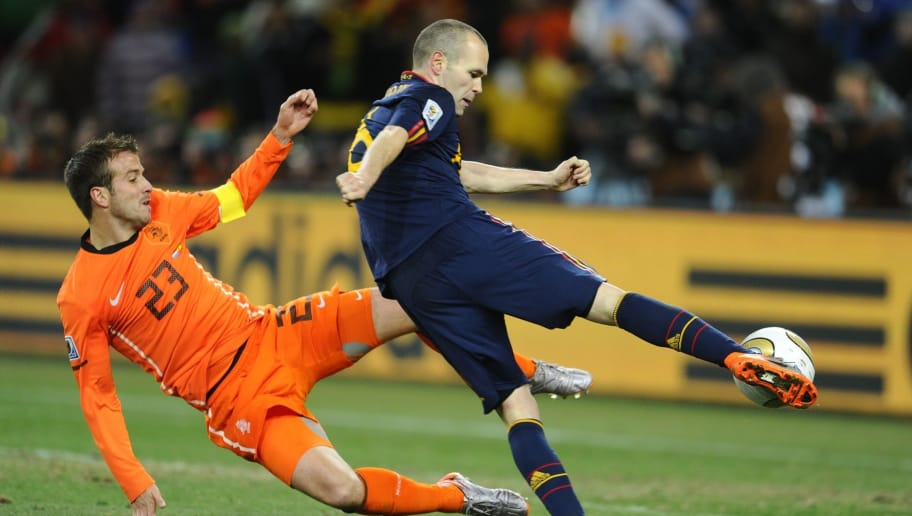 Spain's midfielder Andrés Iniesta (R) shoots and scores a goal during extra time the 2010 FIFA football World Cup final between the Netherlands and Spain on July 11, 2010 at Soccer City stadium in Soweto, suburban Johannesburg. NO PUSH TO MOBILE / MOBILE USE SOLELY WITHIN EDITORIAL ARTICLE -  AFP PHOTO / PIERRE-PHILIPPE MARCOU (Photo credit should read PIERRE-PHILIPPE MARCOU/AFP/Getty Images)