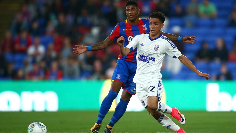 LONDON, ENGLAND - AUGUST 22: Tristan Nydam of Ipswich puts pressure on Patrick van Aanholt of Crystal Palace during the Carabao Cup Second Round match between Crystal Palace and Ipswich Town at Selhurst Park on August 22, 2017 in London, England.  (Photo by Jordan Mansfield/Getty Images)