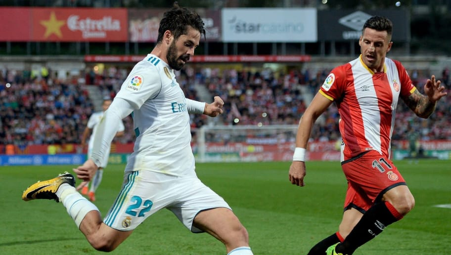 Real Madrid's midfielder Isco (L) vies with Girona's Spanish defender Francisco Aday during the Spanish league football match Girona FC vs Real Madrid CF at the Montilivi stadium in Girona on October 29, 2017. / AFP PHOTO / Josep LAGO        (Photo credit should read JOSEP LAGO/AFP/Getty Images)