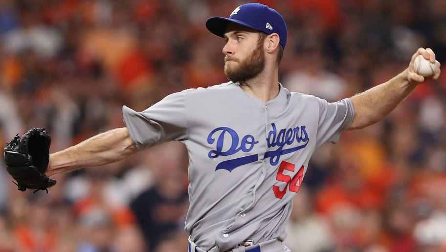 HOUSTON, TX - OCTOBER 29:  Tony Cingrani #54 of the Los Angeles Dodgers throws a pitch during the eighth inning against the Houston Astros in game five of the 2017 World Series at Minute Maid Park on October 29, 2017 in Houston, Texas.  (Photo by Christian Petersen/Getty Images)