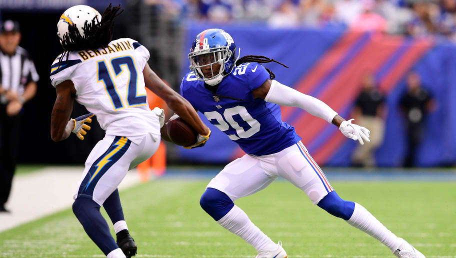 EAST RUTHERFORD, NJ - OCTOBER 08:  Travis Benjamin #12 of the Los Angeles Chargers is knocked out of bounds by Janoris Jenkins #20 of the New York Giants in the first quarter during an NFL game at MetLife Stadium on October 8, 2017 in East Rutherford, New Jersey.  (Photo by Steven Ryan/Getty Images)