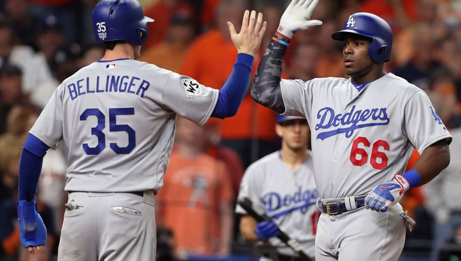 HOUSTON, TX - OCTOBER 29:  Yasiel Puig #66 of the Los Angeles Dodgers celebrates hitting a two-run home run during the ninth inning with Cody Bellinger #35 against the Houston Astros in game five of the 2017 World Series at Minute Maid Park on October 29, 2017 in Houston, Texas.  (Photo by Christian Petersen/Getty Images)
