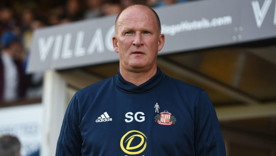 BURY, ENGLAND - AUGUST 10: Simon Grayson manager of Sunderland looks on during the Carabao Cup First Round match between Bury and Sunderland at Gigg Lane on August 10, 2017 in Bury, England. (Photo by Nathan Stirk/Getty Images)