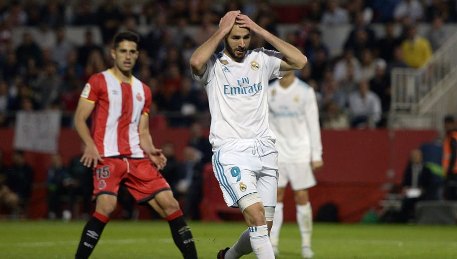 7c2856400 Real Madrid s French forward Karim Benzema (R) gestures during the Spanish  league football match