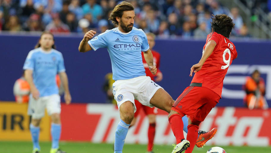 NEW YORK, NY - MARCH 13:  Andrea Pirlo #21 of New York City FC carries the ball against Toronto FC at Yankee Stadium on March 13, 2016 in the Bronx borough of New York City.  (Photo by Mike Stobe/Getty Images)