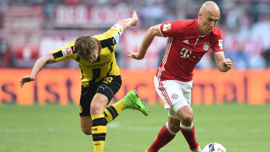 Dortmund's defender Marcel Schmelzer (L) and Bayern Munich's Dutch midfielder Arjen Robben (R) vie for the ball during the German first division Bundesliga football match FC Bayern Munich v BVB Borussia Dortmund in Munich, southern Germany, on April 8, 2017. / AFP PHOTO / Christof STACHE / RESTRICTIONS: DURING MATCH TIME: DFL RULES TO LIMIT THE ONLINE USAGE TO 15 PICTURES PER MATCH AND FORBID IMAGE SEQUENCES TO SIMULATE VIDEO. == RESTRICTED TO EDITORIAL USE == FOR FURTHER QUERIES PLEASE CONTACT DFL DIRECTLY AT + 49 69 650050         (Photo credit should read CHRISTOF STACHE/AFP/Getty Images)