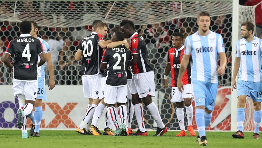 Nice's Italian forward Mario Balotelli (C) is congratulated by teammates after scoring a goal during the UEFA Europa League football match between Nice and Lazio on October 19, 2017, at the Allianz Riviera stadium in Nice, southeastern France.  / AFP PHOTO / VALERY HACHE        (Photo credit should read VALERY HACHE/AFP/Getty Images)