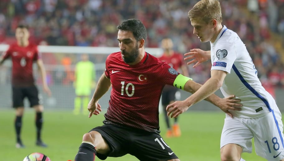 Turkey's midfielder Arda Turan (L) vies with Finland's Jere Uronen (R) during the Fifa World Cup 2018 qualification football match between Turkey and Finland on March 24, 2017 at Antalya arena stadium in Antalya.  / AFP PHOTO / STR        (Photo credit should read STR/AFP/Getty Images)