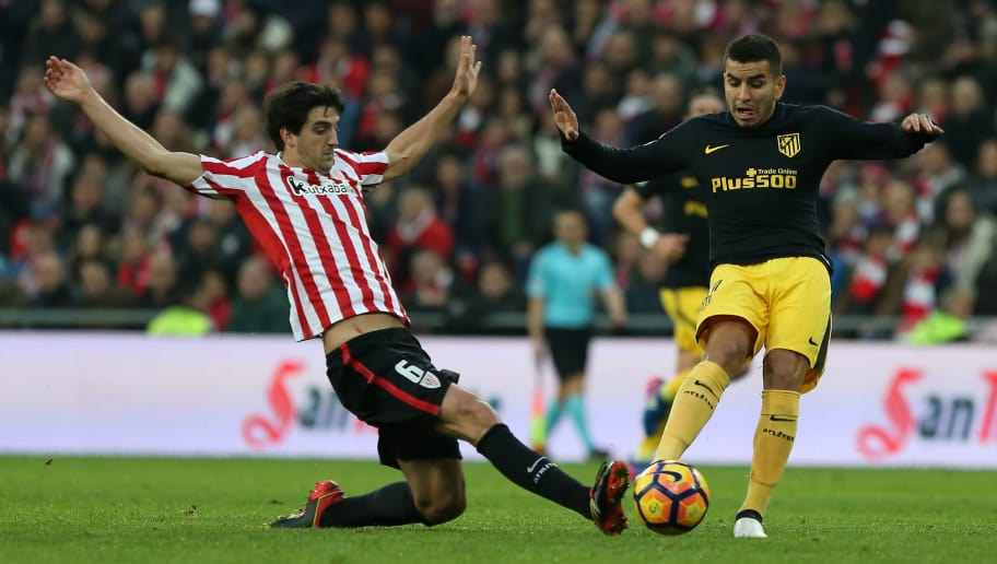 Athletic Bilbao's defender Mikel San Jose (L) vies with Atletico Madrid's Argentinian midfielder Angel Correa during the Spanish league football match Athletic Club Bilbao vs Club Atletico de Madrid at the San Mames stadium in Bilbao on January 22, 2017. / AFP / CESAR MANSO        (Photo credit should read CESAR MANSO/AFP/Getty Images)