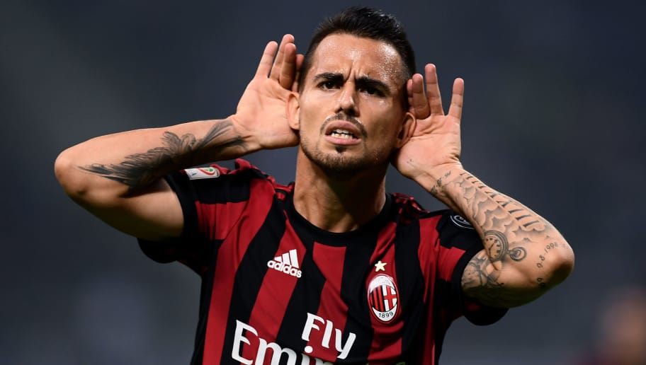 AC Milan's midfielder Suso from Spain celebrates after scoring during the Italian Serie A football match Inter Milan Vs AC Milan on October 15, 2017 at the 'San Siro Stadium' in Milan.  / AFP PHOTO / MARCO BERTORELLO        (Photo credit should read MARCO BERTORELLO/AFP/Getty Images)