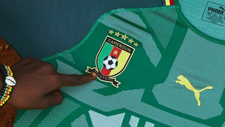 c337b86fb PHOTOS  Cameroon Launch Striking New PUMA Home Kit With Help From ...