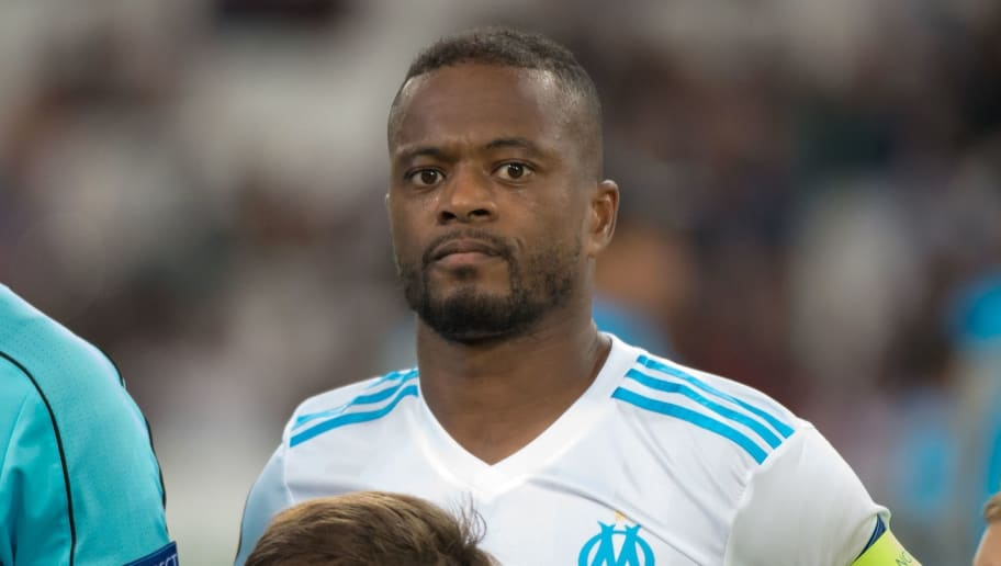 Olympique de Marseille's French defender Patrice Evra (L) looks on next to Olympique de Marseille's French goalkeeper Steve Mandanda prior to the UEFA Europa League Group I football match Marseille vs Vitoria Guimaraes on October 19, 2017 at the Velodrome stadium in Marseille, southeastern France.   / AFP PHOTO / BERTRAND LANGLOIS        (Photo credit should read BERTRAND LANGLOIS/AFP/Getty Images)