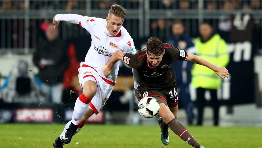 HAMBURG, GERMANY - MARCH 10:  Marc Hornschuh (L) of St. Pauli and Sebastian Polter of Union Berlin battle for the ball during the Second Bundesliga match between FC St. Pauli and 1. FC Union Berlin at Millerntor Stadium on March 10, 2017 in Hamburg, Germany.  (Photo by Martin Rose/Bongarts/Getty Images)