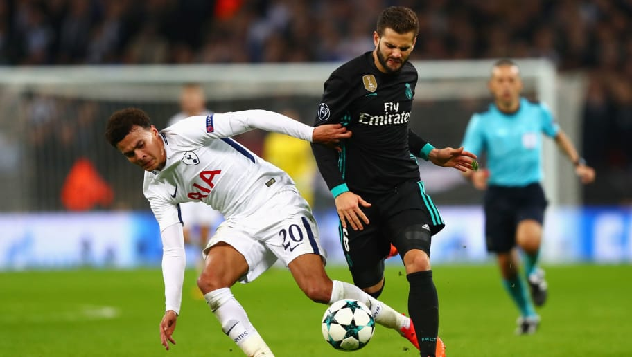 LONDON, ENGLAND - NOVEMBER 01:  Dele Alli of Tottenham Hotspur and Nacho Fernandez of Real Madrid battle for the ball during the UEFA Champions League group H match between Tottenham Hotspur and Real Madrid at Wembley Stadium on November 1, 2017 in London, United Kingdom.  (Photo by Clive Rose/Getty Images)