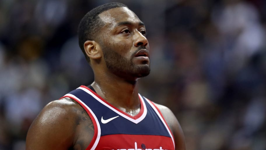 WASHINGTON, DC - NOVEMBER 3: John Wall #2 of the Washington Wizards looks on against the Cleveland Cavaliers in the first half at Capital One Arena on November 3, 2017 in Washington, DC. NOTE TO USER: User expressly acknowledges and agrees that, by downloading and or using this photograph, User is consenting to the terms and conditions of the Getty Images License Agreement. (Photo by Rob Carr/Getty Images)