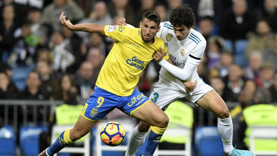 Las Palmas' Argentinian forward Jonathan Calleri (L) challenges Real Madrid's Spanish defender Jesus Vallejo during the Spanish league football match Real Madrid CF vs UD Las Palmas at the Santiago Bernabeu stadium in Madrid on November 5, 2017. / AFP PHOTO / GABRIEL BOUYS        (Photo credit should read GABRIEL BOUYS/AFP/Getty Images)
