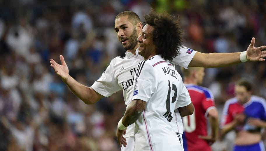 Real Madrid's French forward Karim Benzema (L) celebrates with Real Madrid's Brazilian defender Marcelo after scoring their fifth goal during the UEFA Champions League football match Real Madrid CF vs FC Basel 1893 at the Santiago Bernabeu stadium in Madrid on September 16, 2014.  AFP PHOTO/ PIERRE-PHILIPPE MARCOU        (Photo credit should read PIERRE-PHILIPPE MARCOU/AFP/Getty Images)