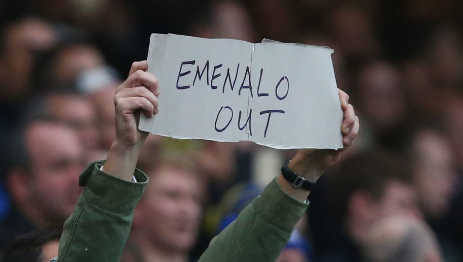 LONDON, ENGLAND - DECEMBER 19: A fan holds a banner to protest against technical director Michael Emenalo during the Barclays Premier League match between Chelsea and Sunderland at Stamford Bridge on December 19, 2015 in London, England.  (Photo by Clive Rose/Getty Images)